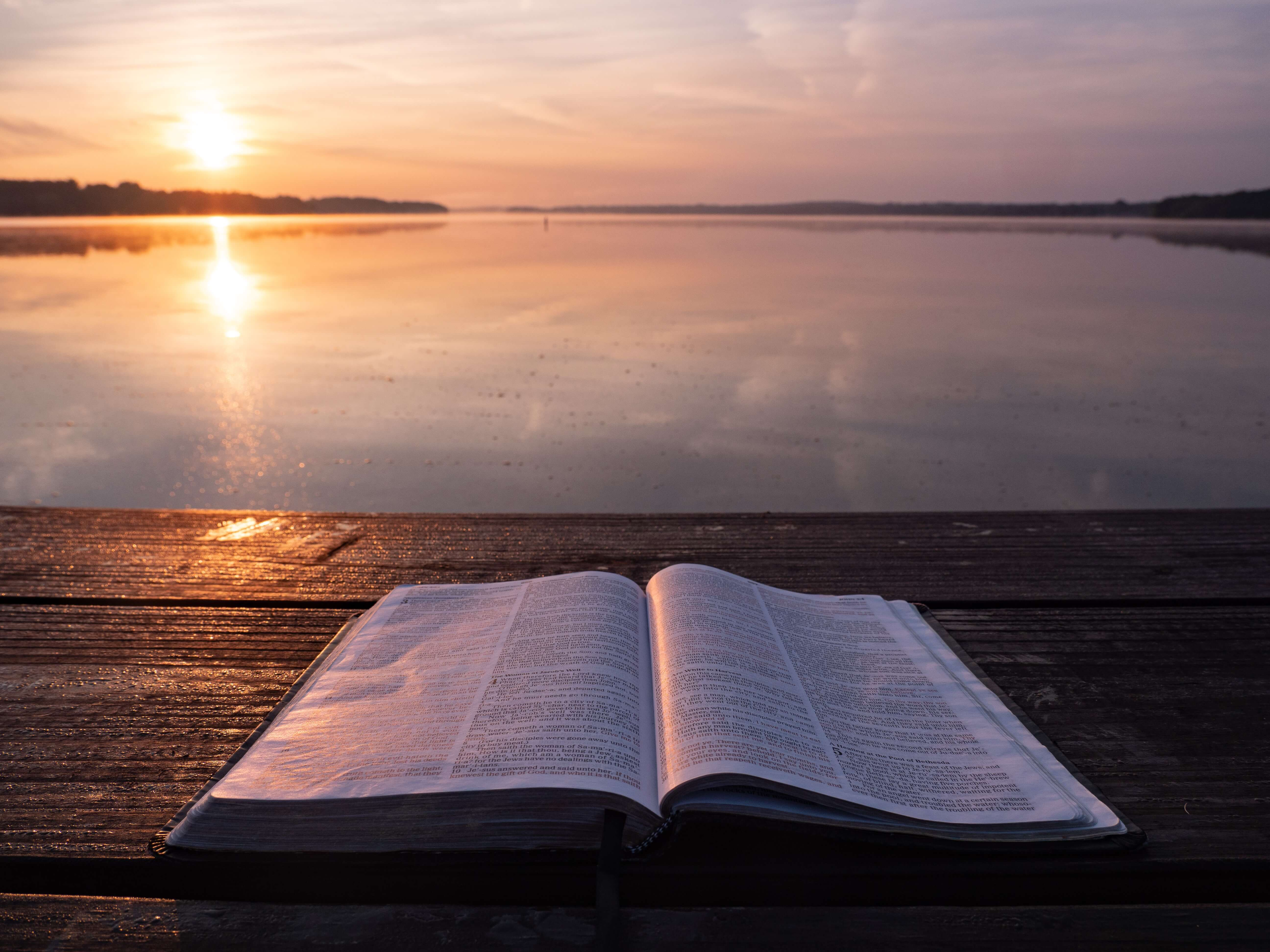 Bible in front of a lake