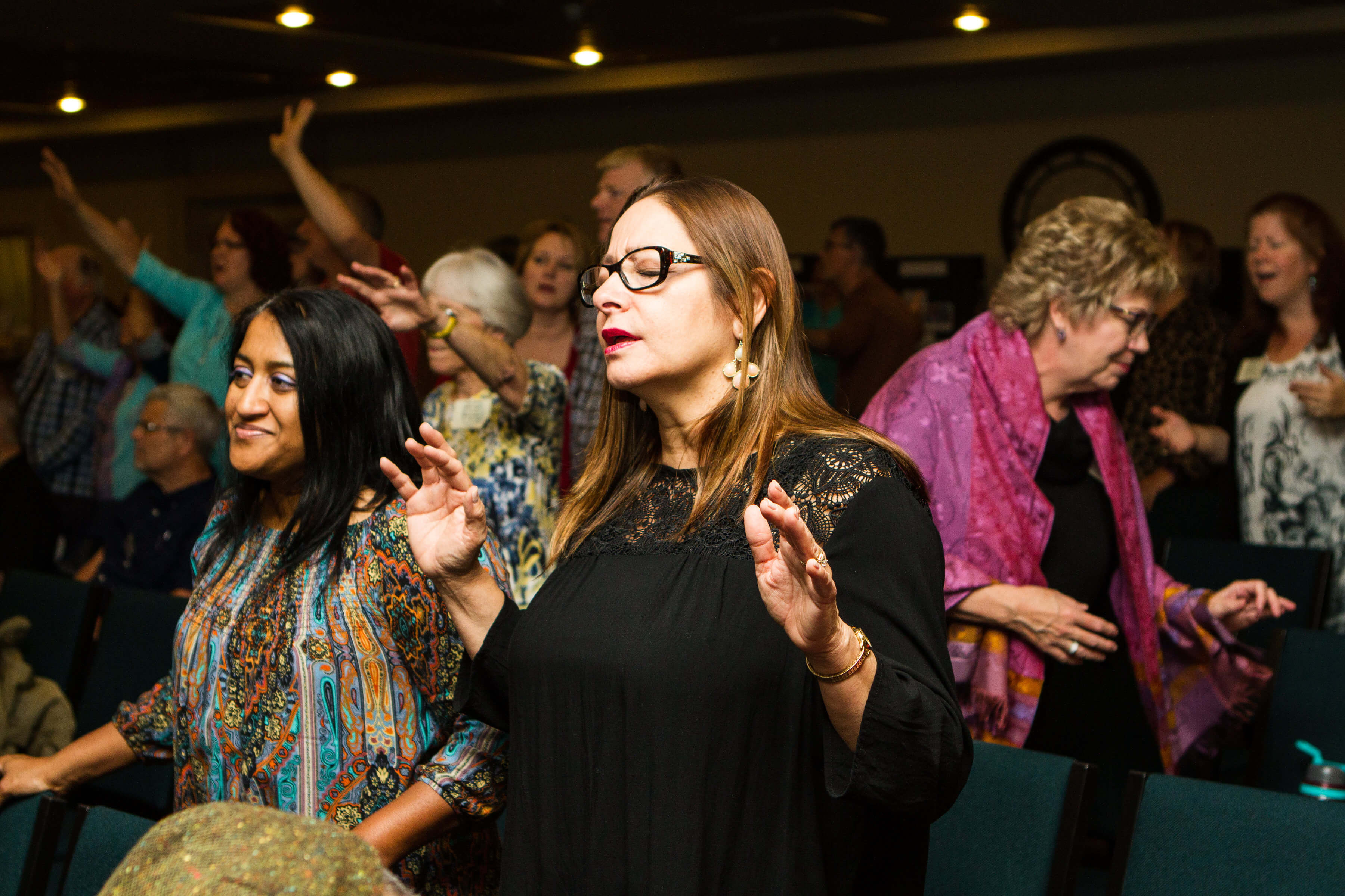 woman worshipping at a conference